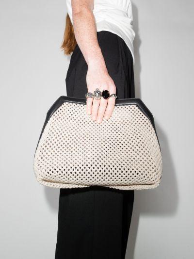 cream four ring woven clutch bag