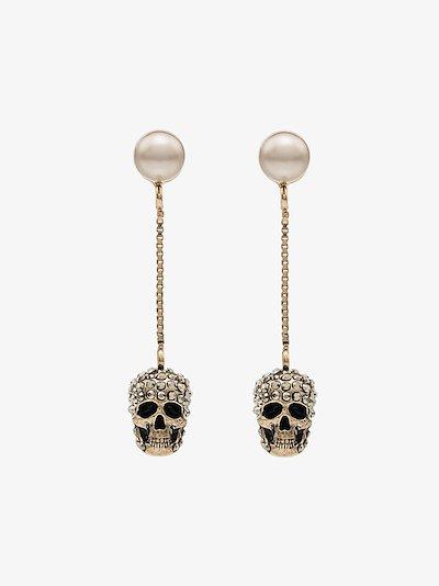 gold tone pavé skull earrings