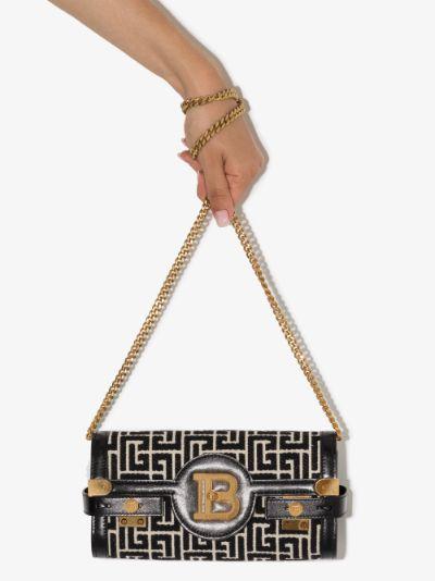 black B-Buzz monogram clutch bag