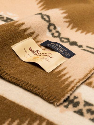 multicoloured woven jacquard blanket