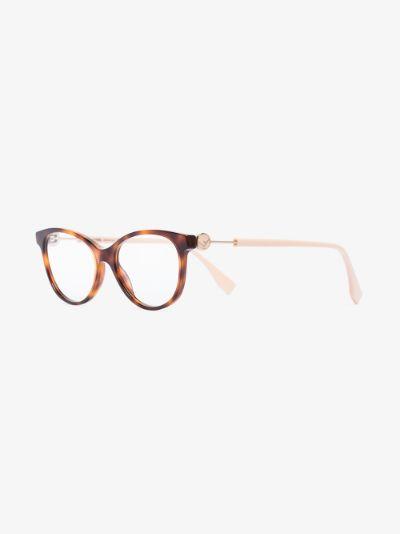 brown and pink round tortoiseshell glasses