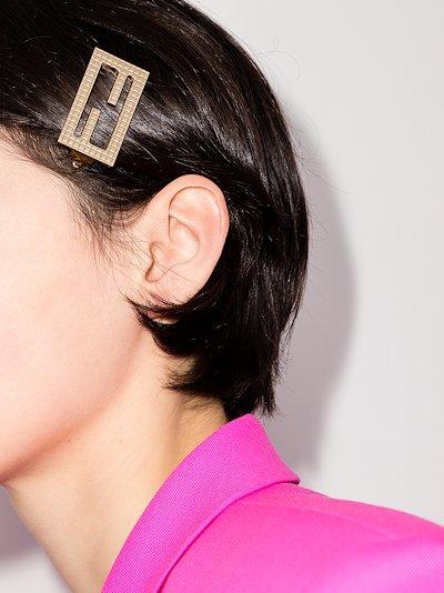 gold tone logo hair clip
