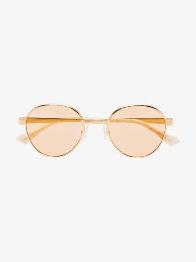 gold tone and yellow round sunglasses