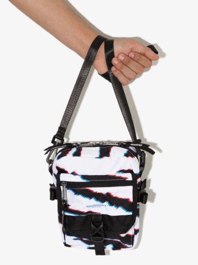 white and black striped messenger bag