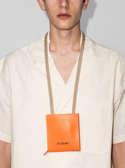 orange le gadjo leather messenger bag