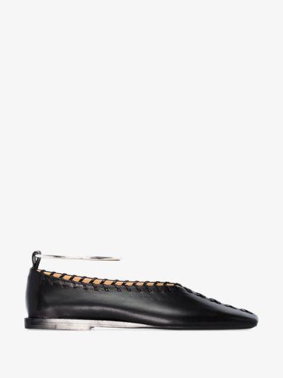 black stitched leather pumps