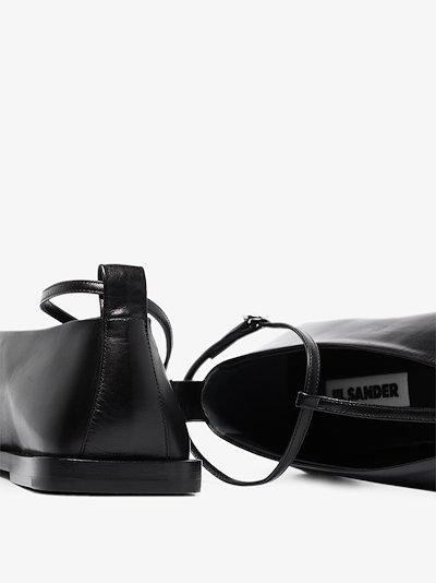 black T-bar leather pumps