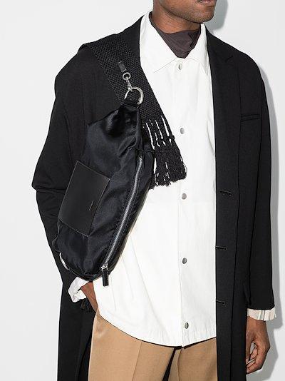 black tasseled cross body bag
