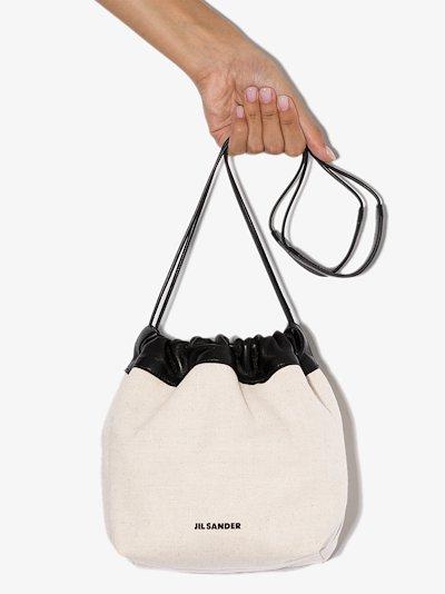 white drawstring leather cross body bag
