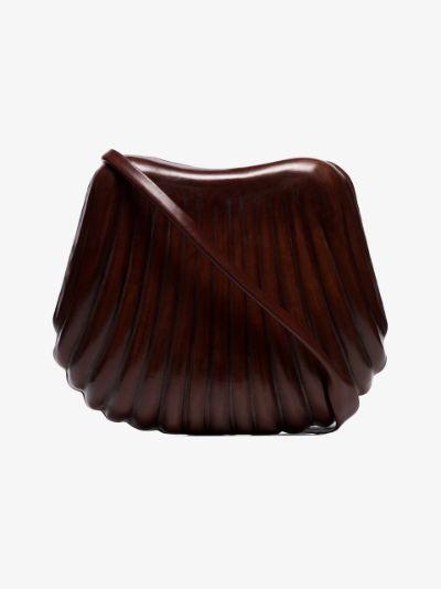 Brown hard leather shell bag