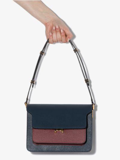blue and burgundy trunk shoulder bag