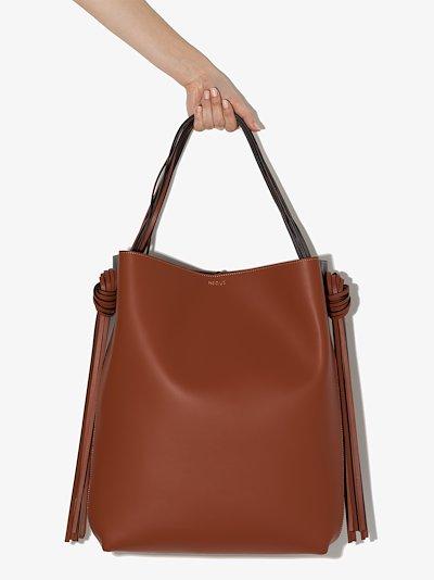 black and brown Saturn leather tote bag