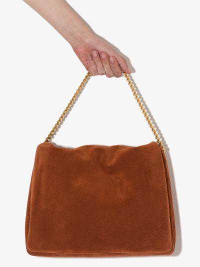 orange Orbit suede shoulder bag