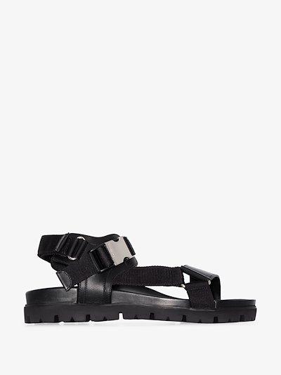 black buckled strap sandals