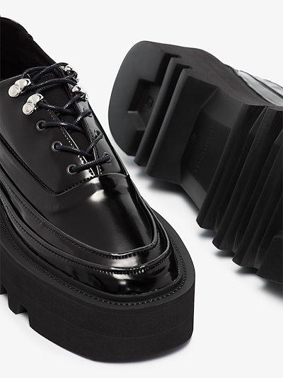 black olov elevator sneakers