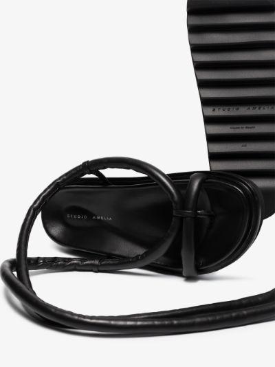 Black tubular flatform sandals