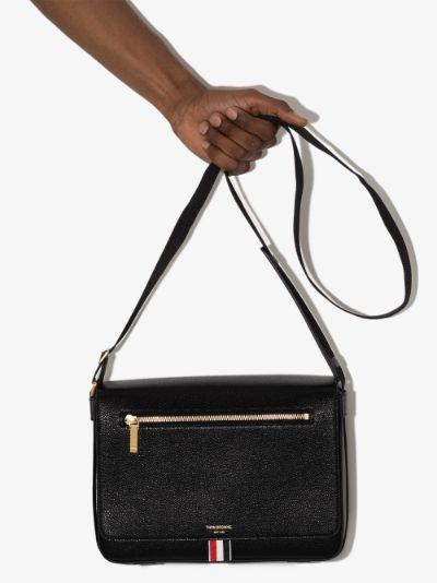 black Reporter leather shoulder bag