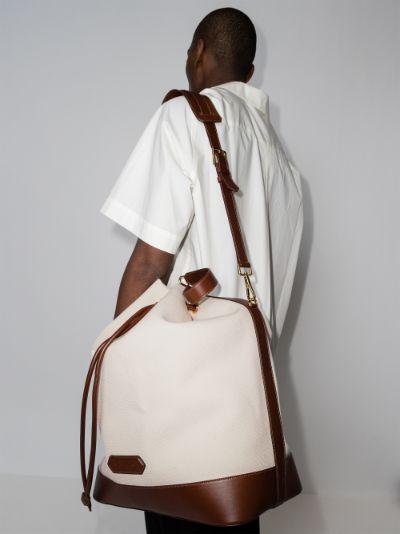 white and brown drawstring bucket bag