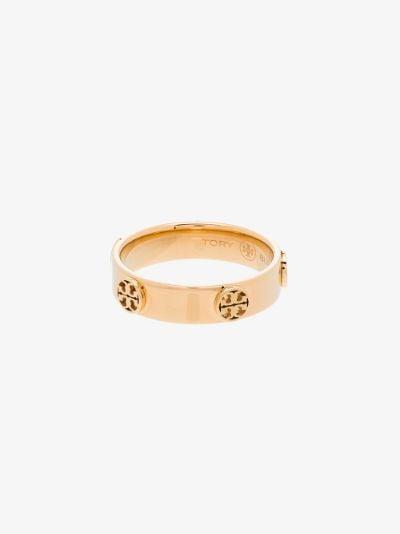gold tone raised serif T logo ring