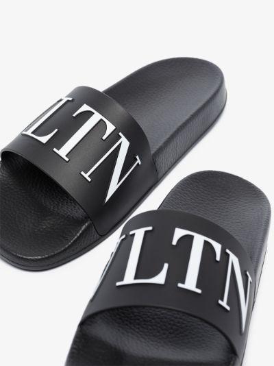 black VLTN logo slides
