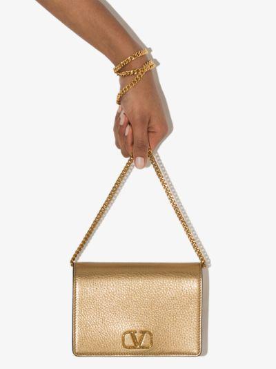 gold logo leather clutch bag
