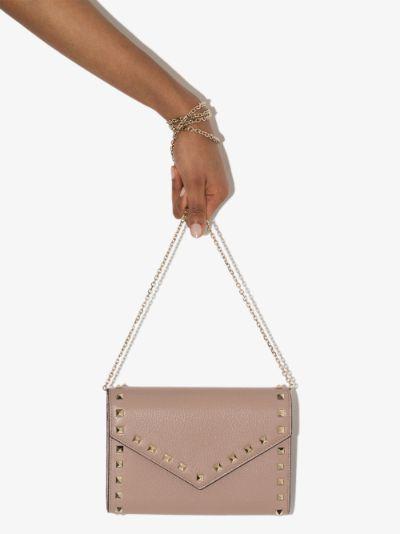 pink Rockstud envelope clutch bag