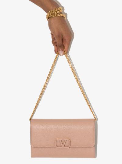 pink VSLING leather clutch bag