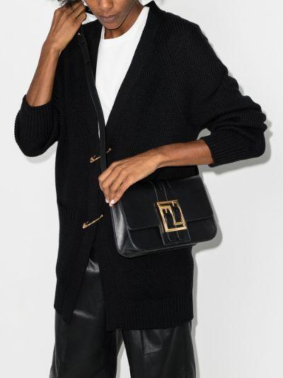 black buckled leather cross body bag