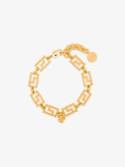 Gold tone Medusa chain bracelet
