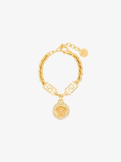 gold tone Medusa rolo chain bracelet