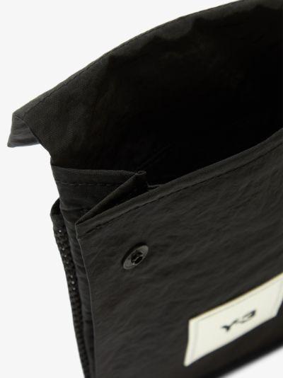 black CH3 pocket messenger bag