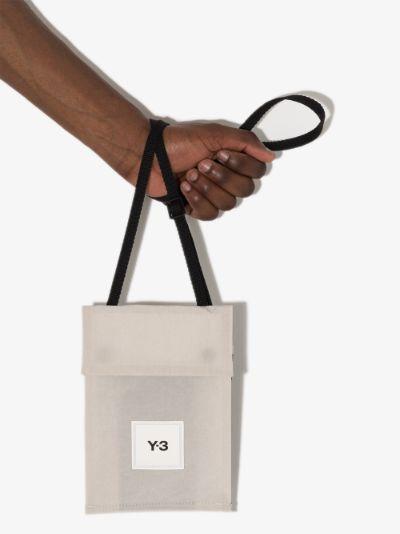 neutral logo patch messenger bag